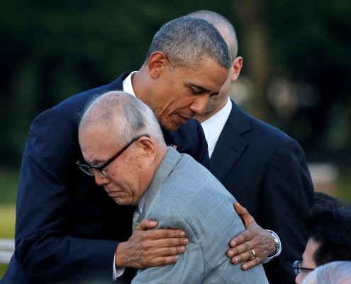 President Barack Obama hugs atomic bomb survivor Shigeaki Mori as he visits Hiroshima Peace Memorial Park in Hiroshima, Japan May 27, 2016. REUTERS/Carlos Barria